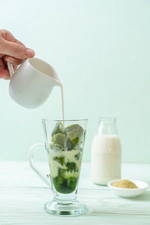 matcha green tea ice cube with milk in glass Stock Photo