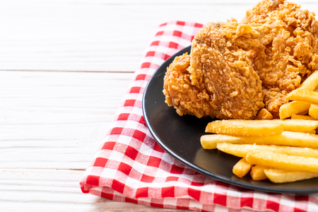 fried chicken with french fries and nuggets meal - junk food and unhealthy food