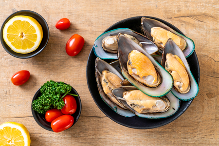 fresh mussel on black bowl