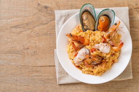 risotto with seafoods (shrimps, mussels, octopus, clams) and tomatoes - Italian food style 스톡 콘텐츠