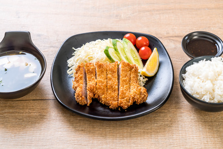 Japanese deep fried pork cutlet (tonkatsu set) - Japanese food style Imagens