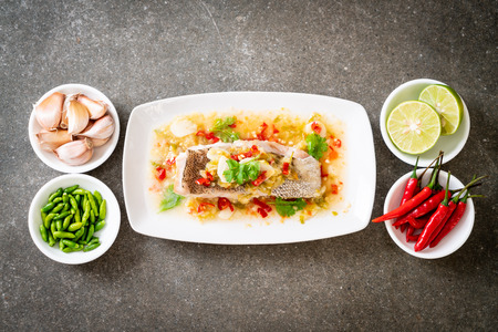 Steamed Grouper Fish Fillet with Chili Lime Sauce in lime dressing - Asian food style Stock Photo - 112698130