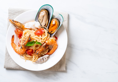Seafood pasta Spaghetti with Clams, Prawns, Squis, Mussel and Tomatoes - Italian food style