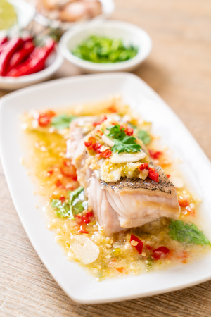 Steamed Grouper Fish Fillet with Chili Lime Sauce in lime dressing - Asian food style