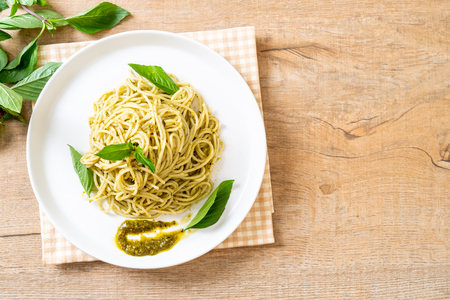 Homamade spaghetti with pesto sauce ,olive oil and basil leaves. Stok Fotoğraf