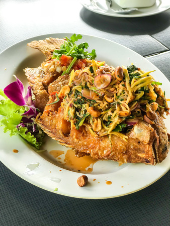 fried fish with herb - Asian food style