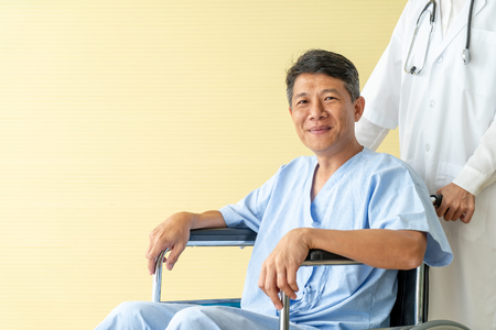 Asian senior patient wheelchair with doctor