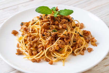 stir-fried spicy spaghetti with minced pork and basil