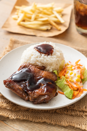 grilled chicken with teriyaki sauce and rice and salad Stock Photo