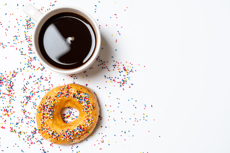 Donut with colorful sprinkles - top view
