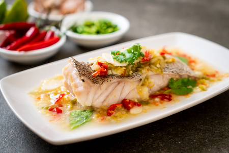 Steamed Grouper Fish Fillet with Chili Lime Sauce in lime dressing - Asian food style Reklamní fotografie - 112559608