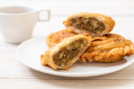 chicken curry puff pastry on wood background Stock fotó