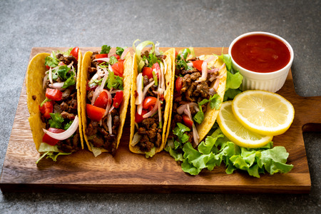 tacos with meat and vegetables  -  Mexican food style Фото со стока
