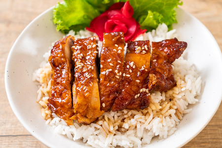 grilled chicken with teriyaki sauce on topped rice bowl