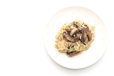 Risotto with mushroom and cheese isolated on white background