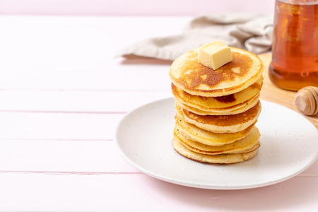 pancakes stack with butter and honey