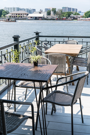 empty outdoor patio table and chair in restaurant and coffee shop 版權商用圖片