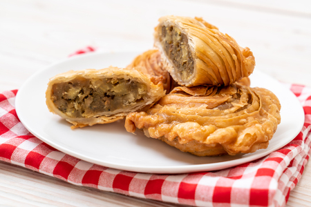 chicken curry puff pastry on wood background Stock Photo