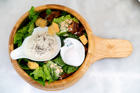 caesar salad on wood bowl - healthy food style