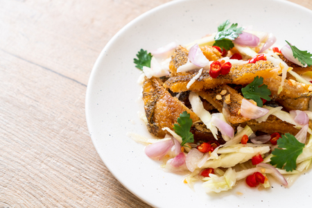 crispy gourami fish with spicy salad - Asian food style Stock Photo