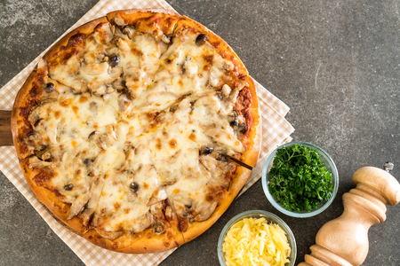 mushroom pizza with miso sauce on table