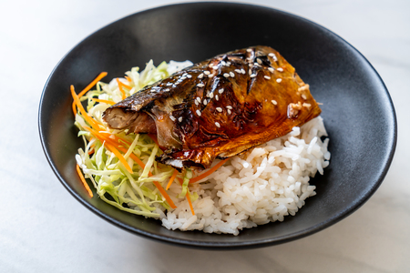 saba fish grilled with teriyaki sauce on topped rice bowl - Japanese style