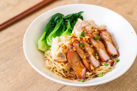 egg noodle with red roasted pork and wonton - Asian food style Reklamní fotografie