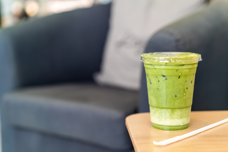 iced matcha latte green tea cup in cafe restaurant