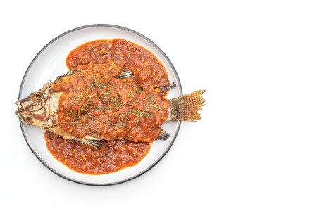 Fried fish with chili sauce isolated on white background