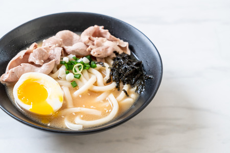 udon ramen noodles with pork soup - Japanese style