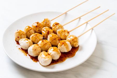 grilled pork meatballs with sweet chili sauce on plate 版權商用圖片