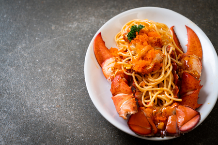 lobster spaghetti with shrimp egg on white plate