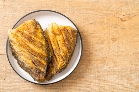 Crispy Gourami Fish on white plate