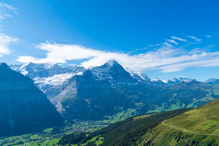Grindelwald village with Alps Mountain and blue sky in Switzerland