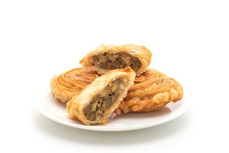 chicken curry puff pastry isolated on white background Фото со стока