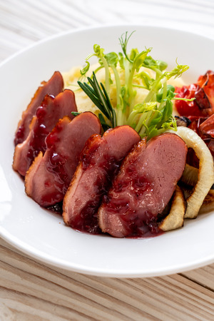 grilled duck with sauce, mash potatoes and vegetable