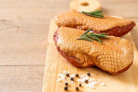 fresh raw duck breast on wood board with ingredients