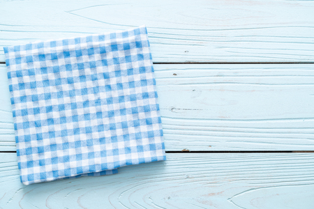 kitchen cloth (napkin) on blue wooden background with copy space Фото со стока