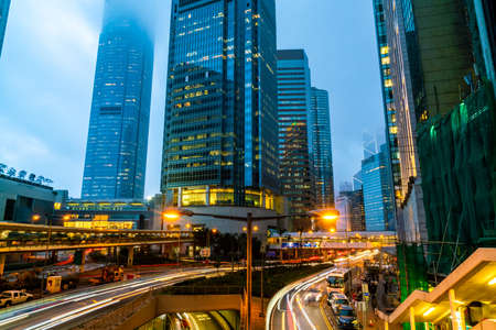 View of traffics with office & commercial buildings in Central area in Hong Kong. Stock Photo