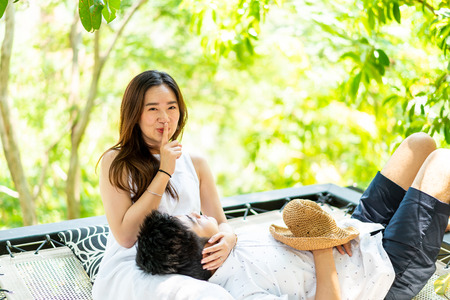 Young and happy Asian couple in love on cradle balcony Stock Photo
