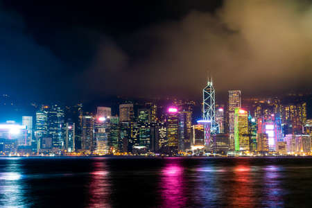 Beautiful architecture building cityscape in Hong Kong city skyline at night and light up