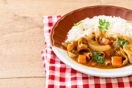 Japanese curry rice with sliced pork, carrot and onions - Asian style Stock Photo