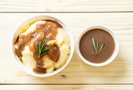 homemade mashed potatoes with gravy sauce 写真素材