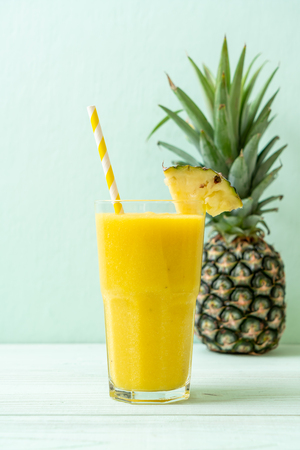 fresh pineapple smoothie glass on wood table - Healthy Drink
