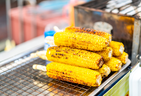 Grilled corns on the grille - Street food style 스톡 콘텐츠