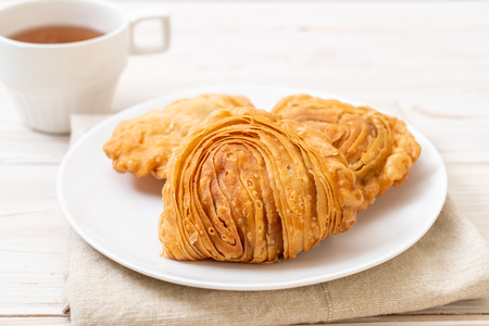chicken curry puff pastry on wood background