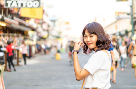 Happy and Beautiful Asian woman traveling at Khao Sarn Road in Thailand