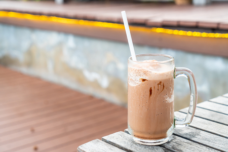a glass of chocolate milkshake with sea view background 写真素材