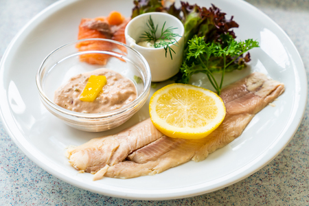 Trout fish steak with lemon and vegetable Stock Photo