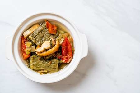 Bitter gourd and preserved mustard green soup with pork - Asian food style